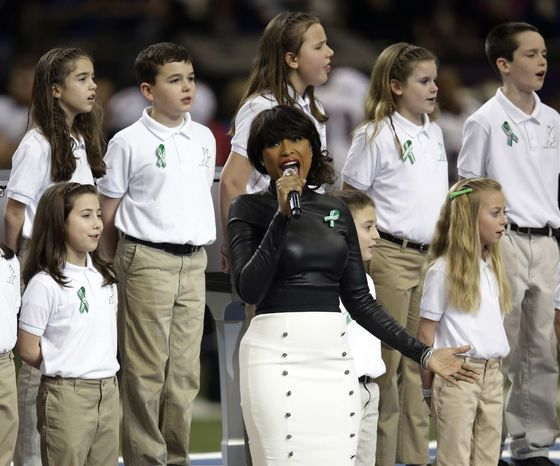 """Jennifer Hudson, center, sings """"God Bless America"""" before the NFL Super Bowl XLVII football game between the San Francisco 49ers and the Baltimore Ravens, Sunday, Feb. 3, 2013, in New Orleans. (AP Photo/Evan Vucci) ** FILE **"""