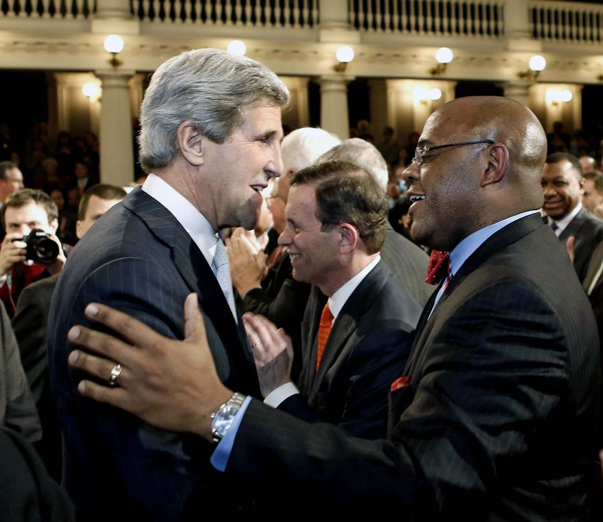 """** FILE ** U.S. Sen. John Kerry greets William """"Mo"""" Cowan, who will occupy his Senate seat temporarily, before addressing constituents at Faneuil Hall in Boston Thursday, Jan. 31, 2013. Kerry will step down tomorrow from the office he has held for nearly three decades to become the next secretary of state. (AP Photo/Winslow Townson)"""