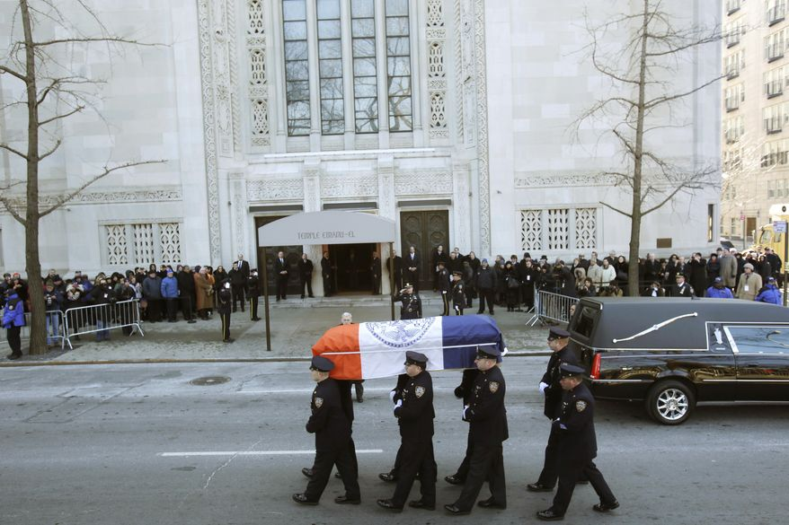 The casket containing the remains of former New York Mayor Ed Koch is carried by policemen into Temple Emanu-El for his funeral in New York on Monday, Feb. 4, 2013. Mr. Koch died Friday of congestive heart failure at age 88. (AP Photo/Seth Wenig)