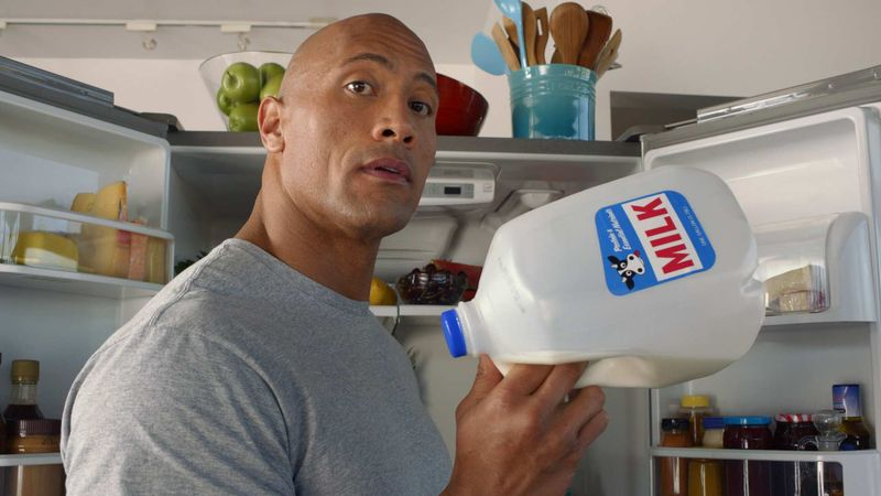 """** FILE ** This undated screenshot provided by the Milk Processor Education Program, known as MilkPep shows the company's Super Bowl advertisement. The Milk Processor Education Program, known as MilkPep and popular for its """"Got Milk?"""" print ads, is featuring actor and professional wrestler Dwayne """"The Rock"""" Johnson in a 30-second ad in the second quarter that is directed by Peter Berg. (AP Photo/Milk Processor Education Program)"""