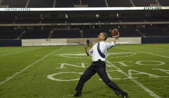 President Obama tosses the rock in 2012 at Soldier Field in Chicago.