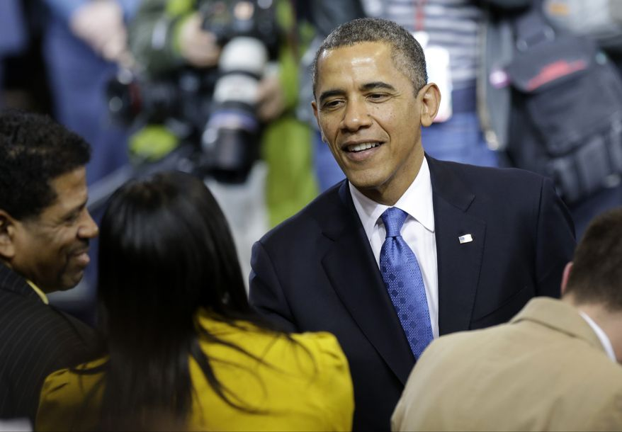 President Obama shakes hands Feb. 4, 2013, with invited guests after he brought his gun-violence proposals on the road to the Minneapolis Police Department's Special Operations Center, where he outlined his plan before law enforcement personnel. (Associated Press)