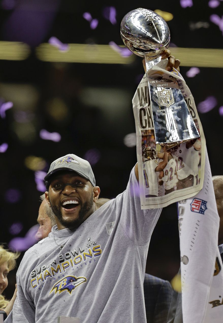 Baltimore Ravens linebacker Ray Lewis (52) holds up the Vince Lombardi Trophy after defeating the San Francisco 49ers 34-31 in the NFL Super Bowl XLVII football game Sunday, Feb. 3, 2013, in New Orleans. (AP Photo/Julio Cortez)
