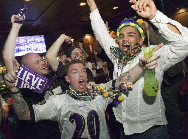 Lee Fuller, of Baltimore, center, and others celebrate the Baltimore Ravens winning the Super Bowl at the Famous Door Bar as fans of the Ravens and San Francisco 49ers NFL football teams pack the French Quarter on Bourbon Street for Super Bowl XLVII in New Orleans, Sunday, Feb. 3, 2013. (AP Photo/Matthew Hinton)