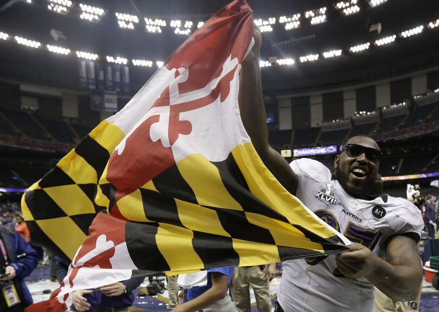 Baltimore Ravens defensive end Arthur Jones celebrates with the Maryland state flag after their 34-31 win against the San Francisco 49ers in the NFL Super Bowl XLVII football game, Sunday, Feb. 3, 2013, in New Orleans. (AP Photo/Dave Martin)
