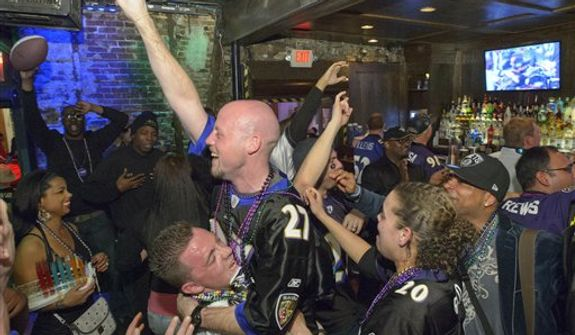 Lee Fuller, of Baltimore, center left, holds up Drew Hutzler, of North Carolina, as others celebrate the Ravens winning the Super Bowl at the Famous Door Bar as fans of the Baltimore Ravens and San Francisco 49ers NFL football teams pack the French Quarter on Bourbon Street for Super Bowl XLVII in New Orleans, Sunday, Feb. 3, 2013. (AP Photo/Matthew Hinton)