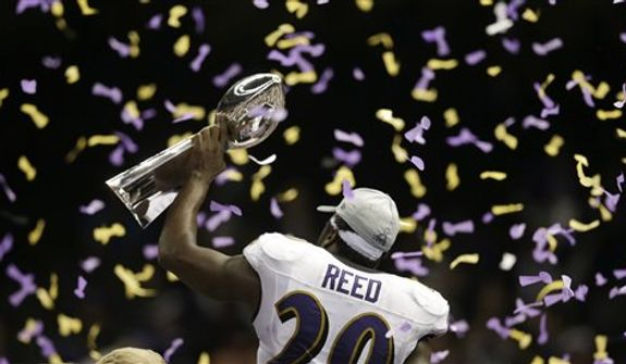 Baltimore Ravens safety Ed Reed (20) holds the Vince Lombardi Trophy after defeating the San Francisco 49ers 34-31 in the NFL Super Bowl XLVII football game, Sunday, Feb. 3, 2013, in New Orleans. (AP Photo/Evan Vucci)