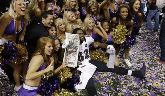 Baltimore Ravens wide receiver Torrey Smith (82) and cheerleaders pose for photos after the team's 34-31 win against the San Francisco 49ers in the NFL Super Bowl XLVII football game Sunday, Feb. 3, 2013, in New Orleans. (AP Photo/David Goldman)
