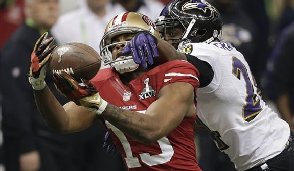 Baltimore Ravens cornerback Corey Graham (24) breaks up a pass intended for San Francisco 49ers wide receiver Michael Crabtree (15) during the second half of the NFL Super Bowl XLVII football game, Sunday, Feb. 3, 2013, in New Orleans. (AP Photo/Bill Haber)