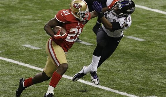 San Francisco 49ers running back Frank Gore (21) stiff-arms Baltimore Ravens cornerback Corey Graham (24) while rushing during the second half of the NFL Super Bowl XLVII football game Sunday, Feb. 3, 2013, in New Orleans. (AP Photo/Gerald Herbert)