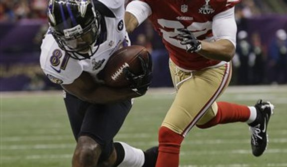 Baltimore Ravens wide receiver Anquan Boldin (81) is forced out of bounds by San Francisco 49ers cornerback Carlos Rogers (22) short of the goal line in the third quarter of the NFL Super Bowl XLVII football game Sunday, Feb. 3, 2013, in New Orleans. (AP Photo/Dave Martin)