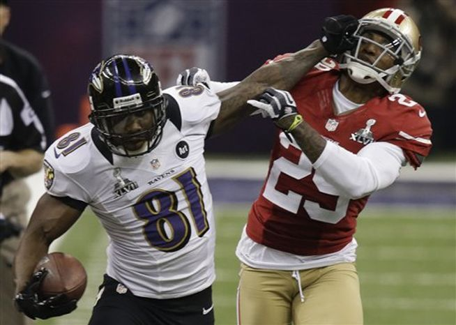 Baltimore Ravens wide receiver Anquan Boldin (81) stiff-arms San Francisco 49ers cornerback Chris Culliver (29) during the second half of the NFL Super Bowl XLVII football game, Sunday, Feb. 3, 2013, in New Orleans. (AP Photo/Gene Puskar)