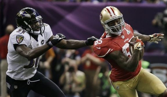 Baltimore Ravens safety Bernard Pollard (31) grabs the jersey of San Francisco 49ers tight end Vernon Davis (85) during the first half of the NFL Super Bowl XLVII football game, Sunday, Feb. 3, 2013, in New Orleans. (AP Photo/Matt Slocum)