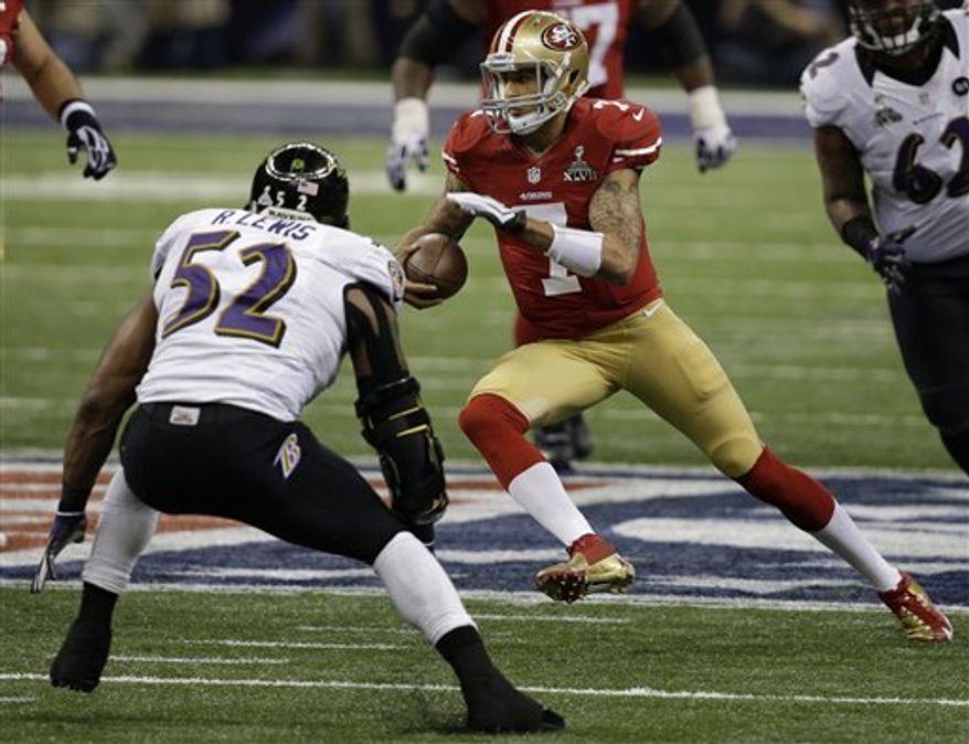 San Francisco 49ers quarterback Colin Kaepernick (7) runs against Baltimore Ravens linebacker Ray Lewis (52) during the first half of NFL Super Bowl XLVII football game Sunday, Feb. 3, 2013, in New Orleans. (AP Photo/Elaine Thompson)