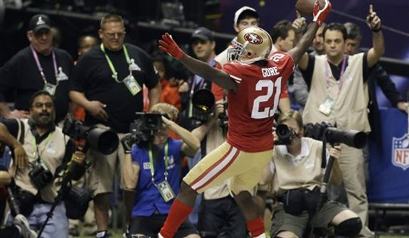 San Francisco 49ers running back Frank Gore (21) celebrates his 6-yard touchdown during the second half of the NFL Super Bowl XLVII football game against the Baltimore Ravens, Sunday, Feb. 3, 2013, in New Orleans. (AP Photo/David Goldman)