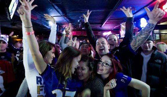 Baltimore Ravens fans celebrate after they score the second touchdown against San Francisco 49ers, at local pub in Baltimore, Md. on Sunday Feb. 3, 2013. (AP Photo/Jose Luis Magana)