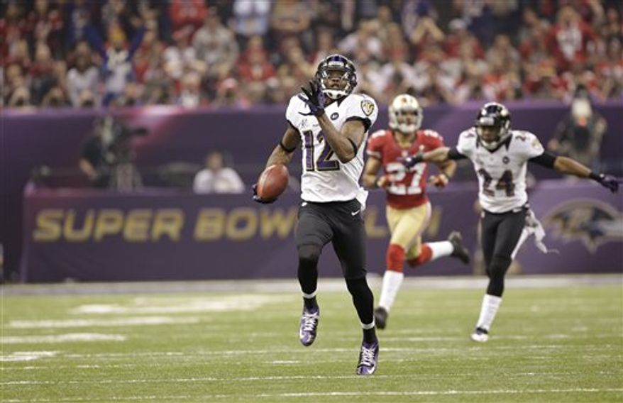 Baltimore Ravens wide receiver Jacoby Jones (12) returns a kickoff 109-yards for a touchdown during the second half of the NFL Super Bowl XLVII football game against the San Francisco 49ers Sunday, Feb. 3, 2013, in New Orleans. (AP Photo/Mark Humphrey)
