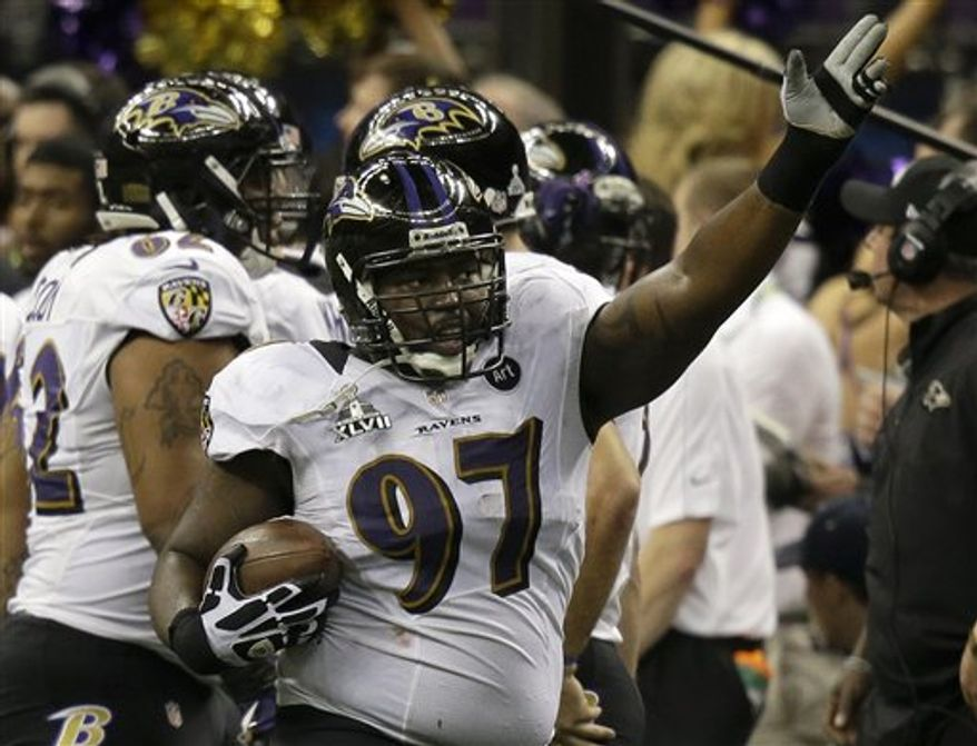 Baltimore Ravens defensive end Arthur Jones (97) celebrates after recovering a fumble by San Francisco 49ers running back LaMichael James during the first half of NFL Super Bowl XLVII football game Sunday, Feb. 3, 2013, in New Orleans. (AP Photo/Gene Puskar)