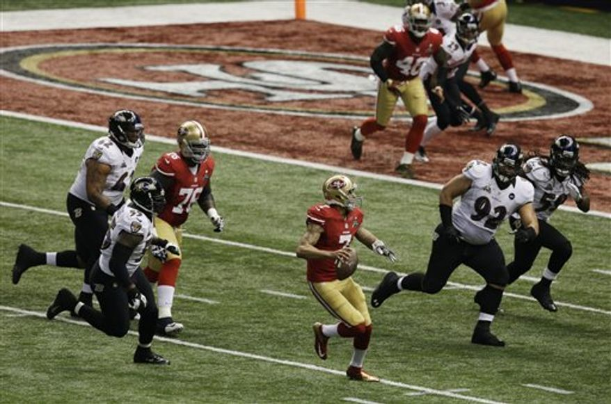 San Francisco 49ers quarterback Colin Kaepernick (7) looks to pass against the Baltimore Ravens during the first half of the NFL Super Bowl XLVII football game Sunday, Feb. 3, 2013, in New Orleans. (AP Photo/Gerald Herbert)