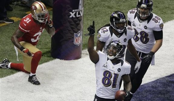 Baltimore Ravens wide receiver Anquan Boldin (81) celebrates his 13-yard touchdown reception with teammates Torrey Smith (82) and Dennis Pitta (88) as San Francisco 49ers safety Donte Whitner (31) recovers during the first half of the NFL Super Bowl XLVII football game, Sunday, Feb. 3, 2013, in New Orleans. (AP Photo/Charlie Riedel)