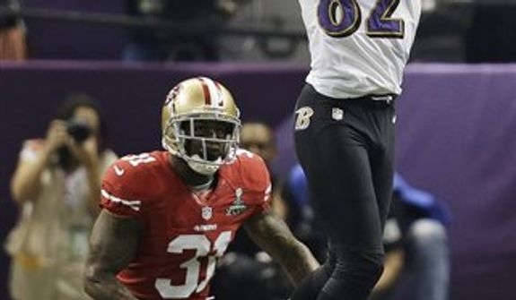 Baltimore Ravens wide receiver Torrey Smith (82) makes a catch against San Francisco 49ers safety Donte Whitner (31) during the first half of the NFL Super Bowl XLVII football game, Sunday, Feb. 3, 2013, in New Orleans. (AP Photo/Elaine Thompson)