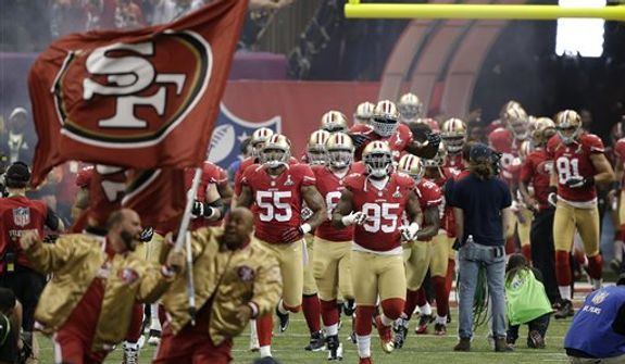 San Francisco 49ers players take the field before the NFL Super Bowl XLVII football game against the Baltimore Ravens Sunday, Feb. 3, 2013, in New Orleans. (AP Photo/Bill Haber)