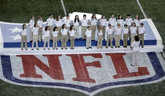 "Students from Sandy Hook Elementary School sing ""America the Beautiful"" before the NFL Super Bowl XLVII football game between the San Francisco 49ers and the Baltimore Ravens Sunday, Feb. 3, 2013, in New Orleans. (AP Photo/Charlie Riedel)"