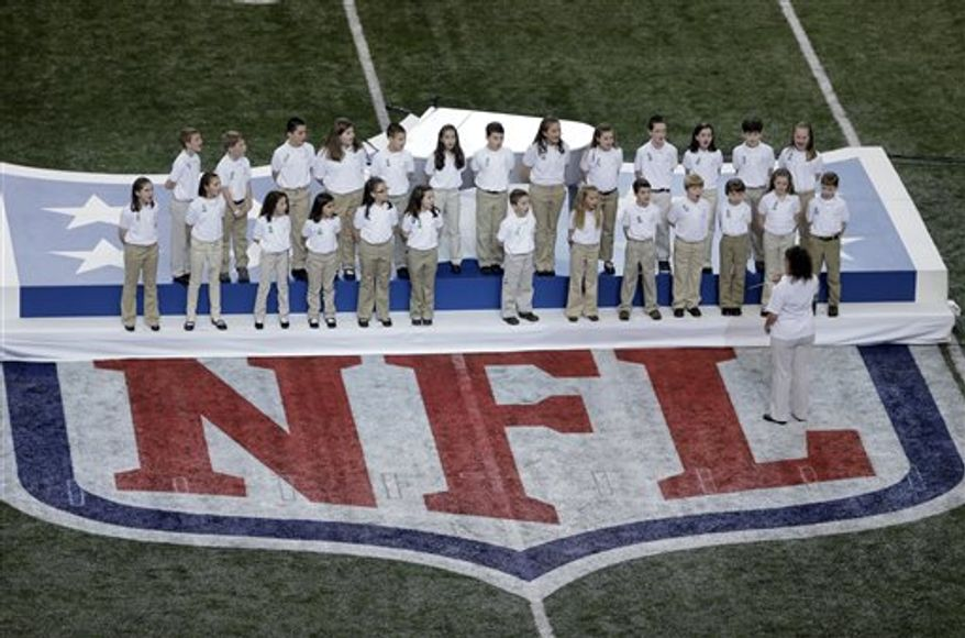 """Students from Sandy Hook Elementary School sing """"America the Beautiful"""" before the NFL Super Bowl XLVII football game between the San Francisco 49ers and the Baltimore Ravens Sunday, Feb. 3, 2013, in New Orleans. (AP Photo/Charlie Riedel)"""