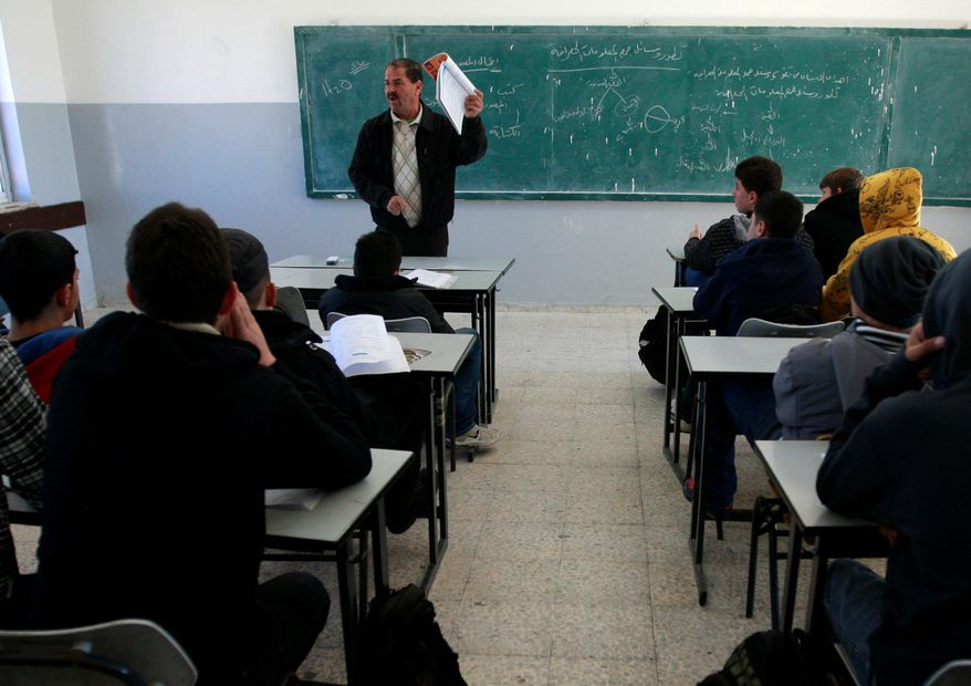 Palestinian students attend class in a Ramallah, West Bank, school Sunday. A U.S.-funded study released Monday said both Israeli and Palestinian schoolbooks largely present one-sided narratives of the two sides' conflict. (Associated Press)