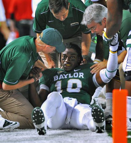 As a Baylor Bears quarterback, Robert Griffin III was knocked out of the game with a concussion while playing the Texas Tech Red Raiders in 2011. Now with the Washington Redskins in the NFL, he has a lot more legal protection against such injuries. (Cal Sport Media via Associated Press)