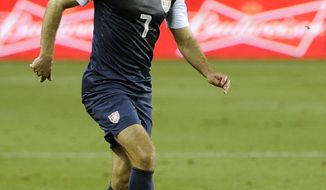 **FILE** U.S. national team's Graham Zusi, a former University of Maryland player, moves the ball in the first half of an exhibition game against Canada Tuesday, Jan. 29, 2013, in Houston. (AP Photo/Pat Sullivan)