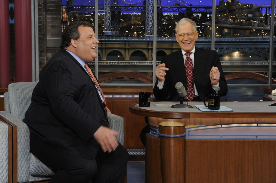 """** FILE ** New Jersey Gov. Chris Christie (left) and late-night host David Letterman react with laughter during the governor's first visit to """"Late Show With David Letterman"""" on Monday, Feb. 4, 2013. (AP Photo/CBS Broadcasting, Jeffrey Neira)"""