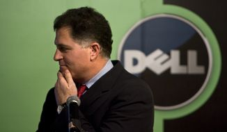 Michael Dell, chairman and CEO of Dell Inc., reacts to a question during a press conference in Beijing in 2009.  (AP Photo/Alexander F. Yuan)