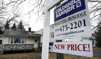 A home is up for sale in North Andover, Mass., on Thursday, Dec. 20, 2012. (AP Photo/Elise Amendola)