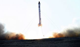 """** FILE ** In this picture obtained from the Iranian Students News Agency, ISNA, the rocket dubbed """"Pishgam,"""" or """"Pioneer,"""" is launched, in an undisclosed location in Iran. A gray-tufted monkey strapped in a pod resembling an infant's car seat rode an Iranian rocket into space and returned safely, officials said Monday, Jan. 28, 2013, in what was described as a step toward Tehran's goal of a manned space flight. (AP Photo/ISNA, Mohammad Agah)"""