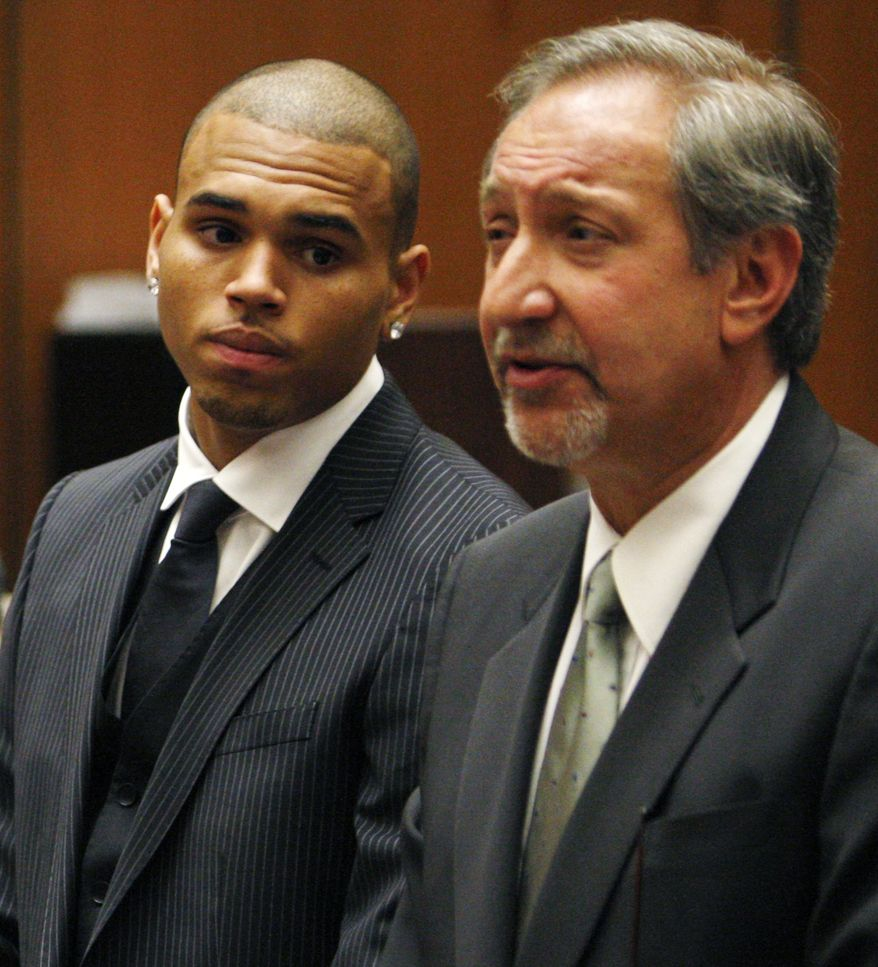 **FILE** Chris Brown looks on alongside his attorney Mark Geragos at Los Angeles County Superior Court in Los Angeles on Aug. 25, 2009, during his sentencing for assaulting his girlfriend Rihanna. (Associated Press)