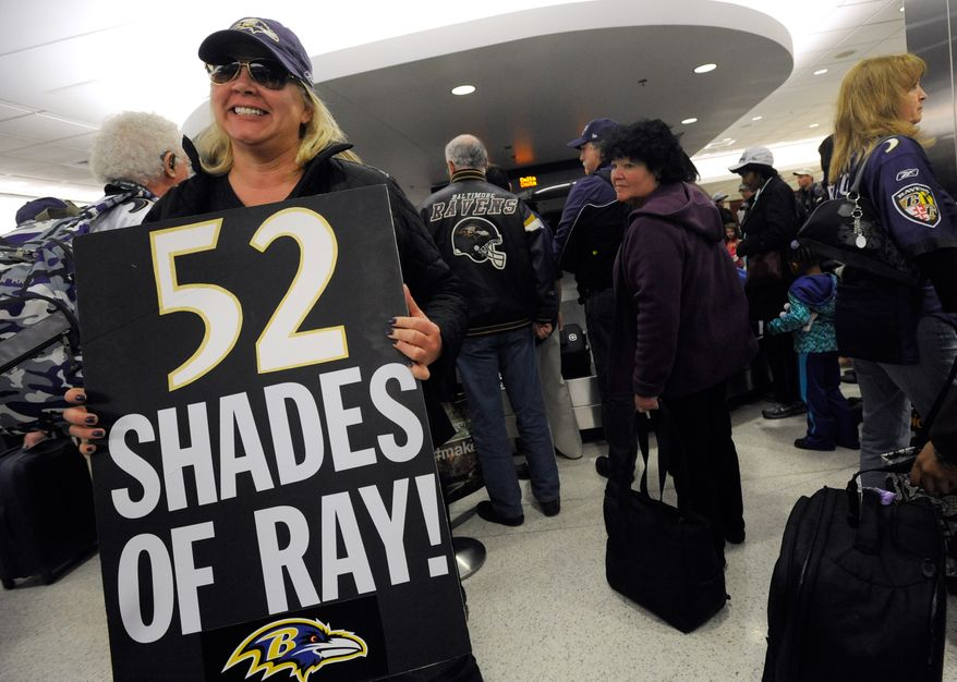 Baltimore Ravens NFL football fan Jen Gaskill holds a sign near the baggage claim at Baltimore-Washington International Thurgood Marshall Airport in Linthicum, Md. after returning Monday, Feb. 4, 2013 from New Orleans to watch the Super Bowl. The Ravens defeated the San Francisco 49ers 34-31. (AP Photo/Steve Ruark)