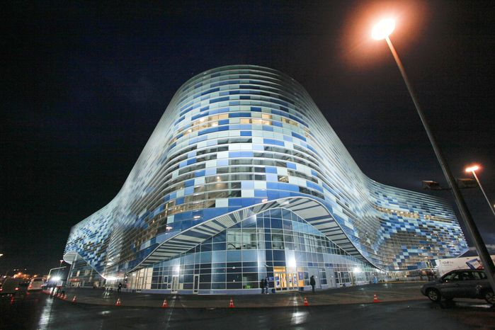 In this photo dated Saturday, Feb. 2, 2013, the Iceberg skating arena seen at night at the Russian Black Sea resort of Sochi, with just one year till the opening ceremony of the winter Olympic 2014 Sochi Games. The Black Sea resort of Sochi is a vast construction site sprawling for nearly 40 kilometers (25 miles) along the coast and 50 kilometers (30 miles) up into the mountains, with no escape from the clang and clatter of the construction works, the drilling, jack-hammering and mixing of cement. (AP Photo/Igor Yakunin)