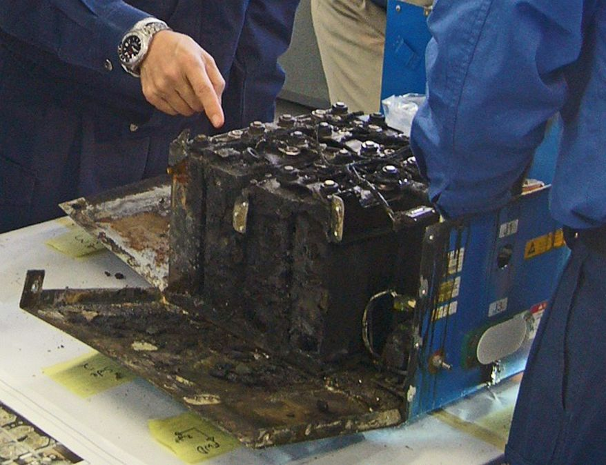 The distorted main lithium-ion battery of the All Nippon Airways' Boeing 787 that had to make an emergency landing is dismantled by investigators in Kyoto, Japan. (Japan Transport Safety Board via Associated Press)