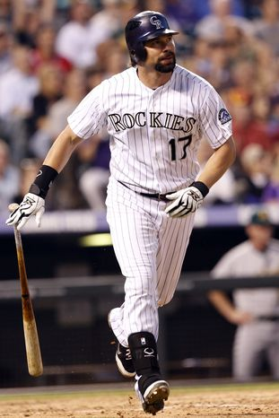 **FILE** Colorado Rockies' Todd Helton watches the flight of a solo home run ball hit off Oakland Athletics starting pitcher Bartolo Colon during the fifth inning of an interleague baseball game, Tuesday, June 12, 2012, in Denver. (AP Photo/Jack Dempsey)