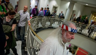 John Drago of Greenbelt, Md., right, and others stand in a long line for hours to testify at a Judicial Proceedings Committee hearing on proposed legislation requiring residents to obtain a license before purchasing a handgun, ban assault weapons, limit magazine capacities to 10 rounds and require prospective gun buyers to complete a safety course and pay a $100 application fee, Annapolis, Md., Wednesday, February 6, 2013. (Andrew Harnik/The Washington Times)