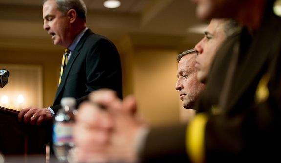 Maryland Gov. Martin O'Malley, third from right, sits after testifying at a Judicial Proceedings Committee hearing to urge state lawmakers to pass legislation requiring residents to obtain a license before purchasing a handgun, ban assault weapons, limit magazine capacities to 10 rounds and require prospective gun buyers to complete a safety course and pay a $100 application fee, Annapolis, Md., Wednesday, February 6, 2013. (Andrew Harnik/The Washington Times)