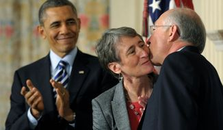 President Obama watches as his Interior Secretary nominee Sally Jewell, a former CEO of REI Inc., gets a kiss from outgoing Secretary Kenneth L. Salazar on Wednesday. The announcement was made in the White House State Dining Room. (Associated Press)