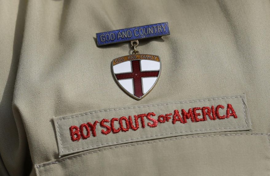** FILE ** This photo taken Monday, Feb. 4, 2013, shows a close up detail of a Boy Scout uniform worn by Brad Hankins, a campaign director for Scouts for Equality, as he responds to questions during a news conference in front of the Boy Scouts of America headquarters in Irving, Texas. (AP Photo/Tony Gutierrez)