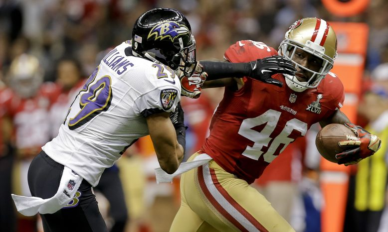 San Francisco 49ers tight end Delanie Walker, right, breaks away from Baltimore Ravens cornerback Cary Williams during the first half of the NFL Super Bowl XLVII football game Sunday, Feb. 3, 2013, in New Orleans. (AP Photo/Marcio Sanchez)