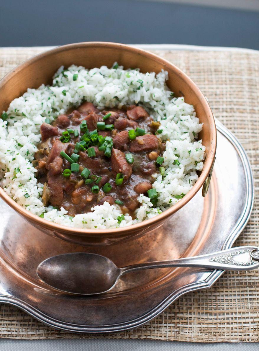 This stewlike red beans and rice menu uses smoked pork hock, andouille sausage and salt pork. (Associated Press)