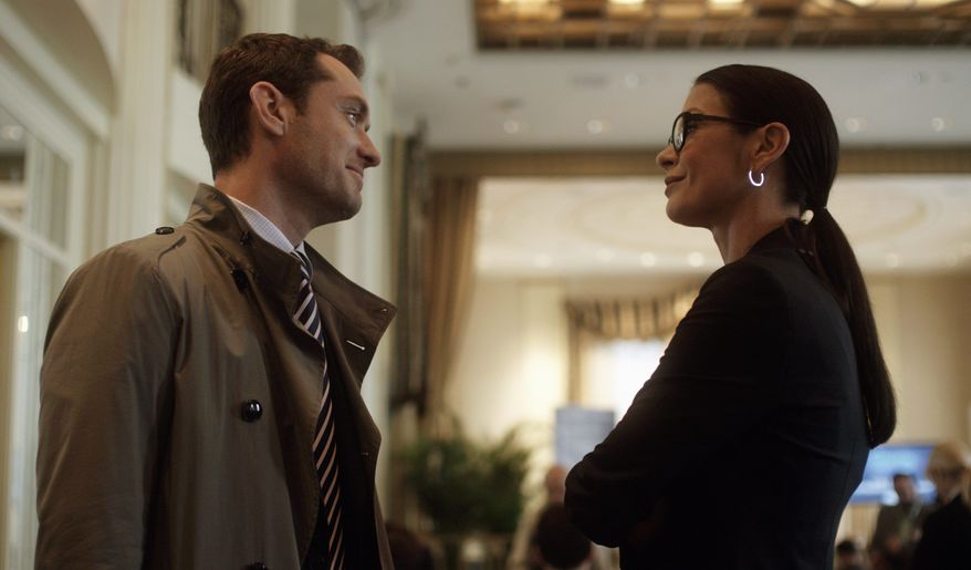 "Characters played by Jude Law and Catherine Zeta-Jones attempt to treat a depressed young wife in the intelligent commercial thriller ""Side Effects."" (Open Road Films via Associated Press)"