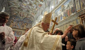 ** FILE ** In this Feb. 7, 2013 file photo, Pope Benedict XVI blesses children in the splendor of the Sistine Chapel.