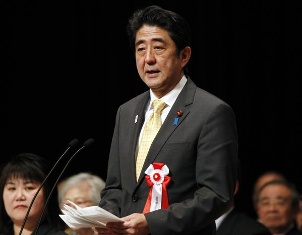 Japanese Prime Minister Shinzo Abe delivers his speech during a national rally marking the Northern Territories Day in Tokyo Thursday, Feb. 7, 2013. Japan reiterated its demand to Russia the return of the four-island chain, known as the Northern Territories in Japan and the Kuril Islands in Russia. (AP Photo/Koji Sasahara)