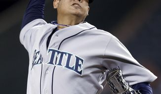 Felix Hernandez throws to a Los Angeles Angels batter during the first inning of a baseball game in Anaheim, Calif., Wednesday, Sept. 26, 2012. (AP Photo/Jae C. Hong)